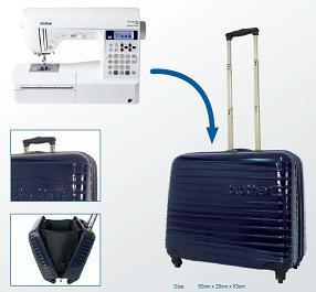 modrý cestovní kufr na kolečkách pro šicí stroje